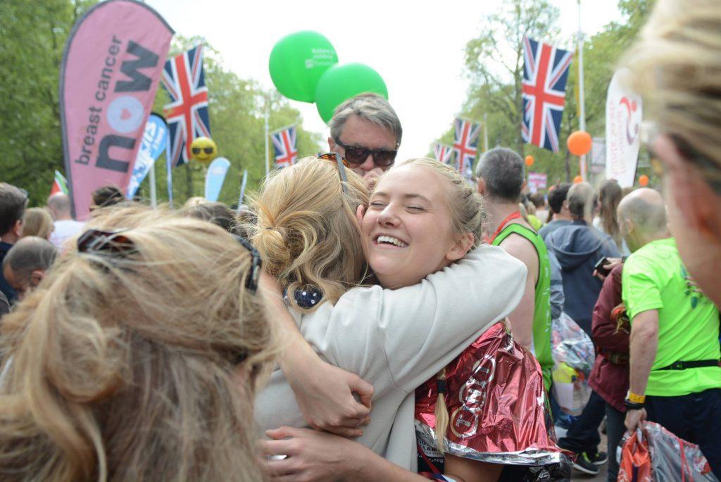 Issy hugs friend